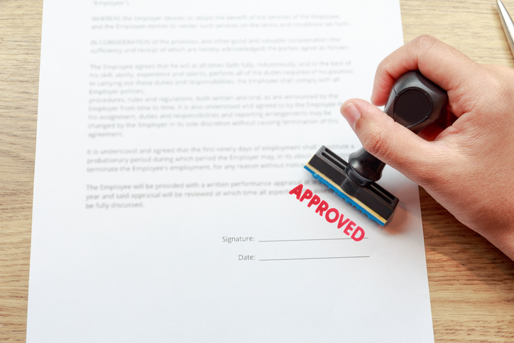 Approved the contract documents with rubber stamp concept